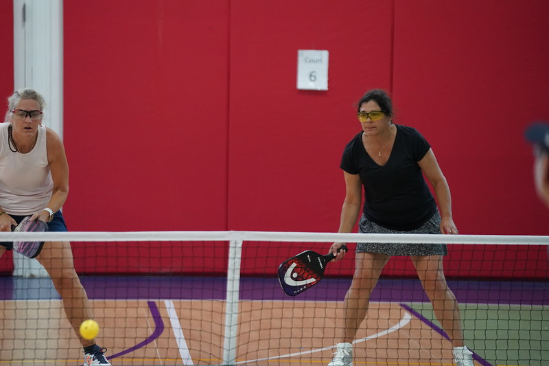 MA Sr Pickleball Tournament - Bev and Chris on Different Court    - 118