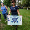 A group of Massachusetts State Police wives have made it their mission to cover Massachusetts in blue in support of all police officers. Kimberley Watson, of Townsend, places a sign in the Lunenburg common. SENTINEL & ENTERPRISE / Ashley Green