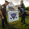 A group of Massachusetts State Police wives have made it their mission to cover Massachusetts in blue in support of all police officers. Lunenburg Police Chief James Marino and Trooper Joseph Hall plant a sign on the town common. SENTINEL & ENTERPRISE / Ashley Green
