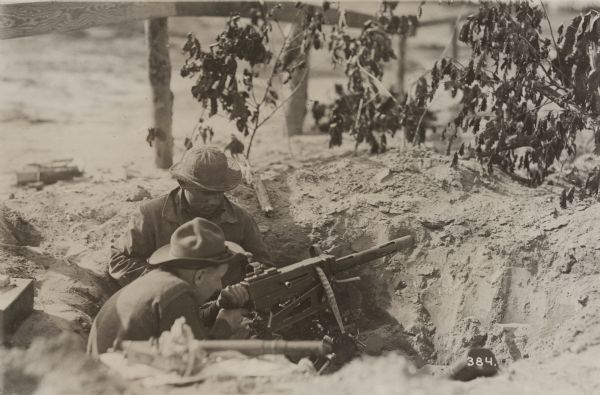 "Title:  World War I Machine Gunner <br /> <br /> Description:  Although handwriting identifies this photograph as ""Machine gun supporting tank attack,"" it is likely, since the print is also identified as having been taken by the Camp Meade photographer, that it depicts artillery training.<br /> <br />  <br /> Wisconsin Historical Images Image ID:  27944 <br /> <br /> Creation Date:  1918 ca."
