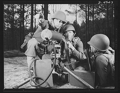 TITLE:  Fort Benning machine gunners. These boys have learned some tricks to show the Axis. This machine gun crew is finishing a sharpening-up course at Fort Benning, Georgia<br /> <br /> LC-USE6- D-004947