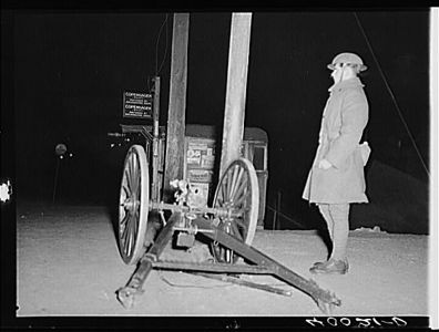 TITLE:  National guardsman with one-pounder, overlooking Chevrolet number nine and<br /> <br /> <br />   LC-USF34- 040021-D