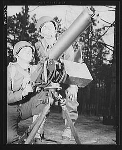 TITLE:  Fort Benning machine gunners. A couple of experts at slowing up the Axis timetable. These two members of a machine gun crew doing post-graduate work at Fort Benning, Georgia have a fast, accurate piece, and they know how to use it<br /> <br /> LC-USE6-D-004952