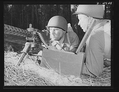 TITLE:  Fort Benning machine gunners. A couple of experts at slowing up the Axis timetable. These two members of a machine gun crew doing post-graduate work at Fort Benning, Georgia have a fast, accurate piece, and they know how to use it<br /> <br /> <br />   LC-USE6- D-004948