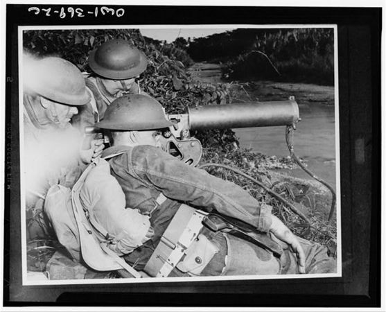 TITLE:  A machine gun crew of American troops in the British West Indies guarding a strategic point along a river during the course of maneuvers<br /> <br /> <br />  LC-USW33- 000369-ZC