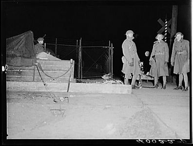 TITLE:  National Guard with machine gun overlooking Chevrolet factories number nine and<br /> <br /> <br />   LC-USF34- 040022-D