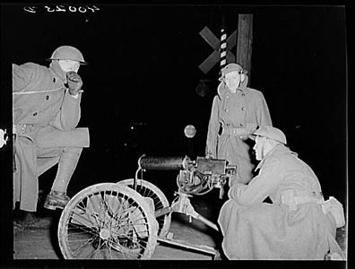 TITLE:  National Guard with machine gun overlooking Chevrolet factories number nine and<br /> <br /> <br />   LC-USF34- 040023-D