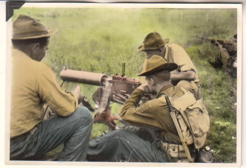 An Original and Authentic 4-1/2 x 6-1/2 inch WWI USMC Marine Machine Gun Crew Fires M1917 Water-Cooled .30 Caliber BMG At Target With Browning Automatic Rifle man Standing By Studio Colorized Photograph Removed From a Combat Album & Marked Minneapolis Minn.