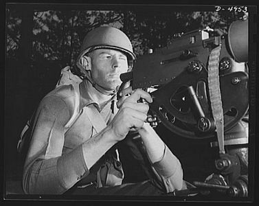 TITLE:  Fort Benning machine gunners. He'll soon be an unpopular figure in Berlin and Tokyo circles. An American machine gunner finishing an intensive training course at Fort Benning, Georgia<br /> <br /> LC-USE6- D-004953