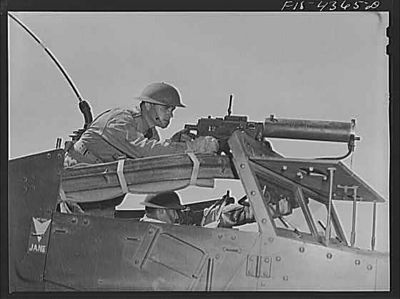 TITLE:  Fort Riley, Kansas. Scout car machine gunner in action during a sham battle<br /> <br /> <br /> <br /> LC-USW3- 004365-D
