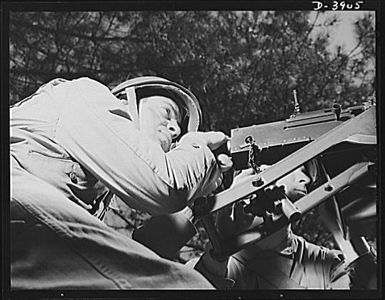 TITLE:  Fort Benning. Halftrac scout cars. He's a good shot, too. A machine gunner on a halftrac scout car gets some target practice as the driver at his left tools the car through the training area at Frot Benning, Georgia<br /> <br /> <br /> <br />  LC-USE6- D-003905