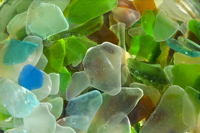 Blue, green, brown, gold, turquoise, and opaque Beach Glass washed up on the beach    North Shore of O'ahu, Hawai'i
