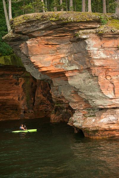 Kayaks travel through the caves