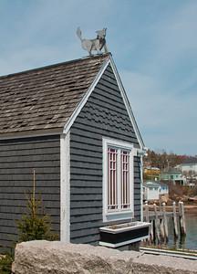 Cat decorative sculpture on top of roof, Stonington, Maine
