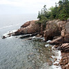 Otter Cliffs, Acadia National Park area, Mount Desert Island, Maine in September, an iconic popular tourist destination. This is classic Maine bold, rocky coast with the Atlantic Ocean lapping the granite boulders of the shore line with stately spruce trees.