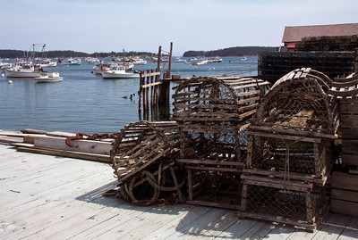 antique wooden lobster traps on wharf, Stonington, Maine