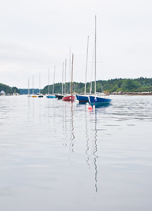 Small Point sailing club boats on moorings with reflections of masts in the water, The Branch, Small Point Harbor, Phippsburg, Maine