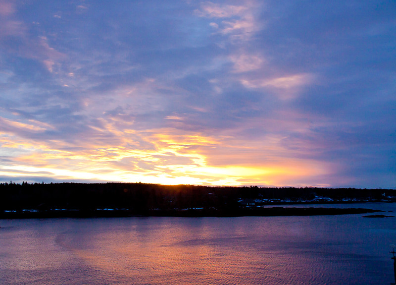 Sunrise over Small Point, Phippsburg, Maine looking east from West Point across Totman Cove with Bailey Point and winter snow, Phippsburg, Maine winter scenic, sky scape, coastal sunrise