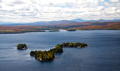 This is an aerial view of Moosehead Lake looking toward Squaw Mountian. I think this is Deer and Whiskey Islands but I'm not sure. September shows good autumn color.