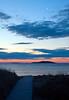 Sunrise Popham Beach State Park with Seguin Island Iighthouse in the background, boardwalk through sand dunes, PHippsburg, Maine