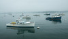 Lobster boat in harbor shrouded in fog, Boothbay Harbor, Linekin Bay, Maine