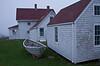 Monhegan museum dory and buildings Maine