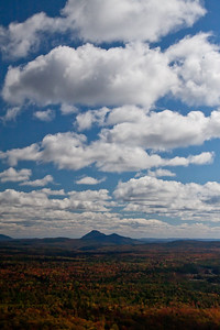 Aerial view of Squaw Mountain, from Moosehead Lake across forests in autumn colors, late September, 2012