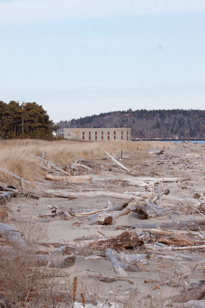 Fort Popham view from south with driftwood on the beach, Phippsburg, Maine, winter view
