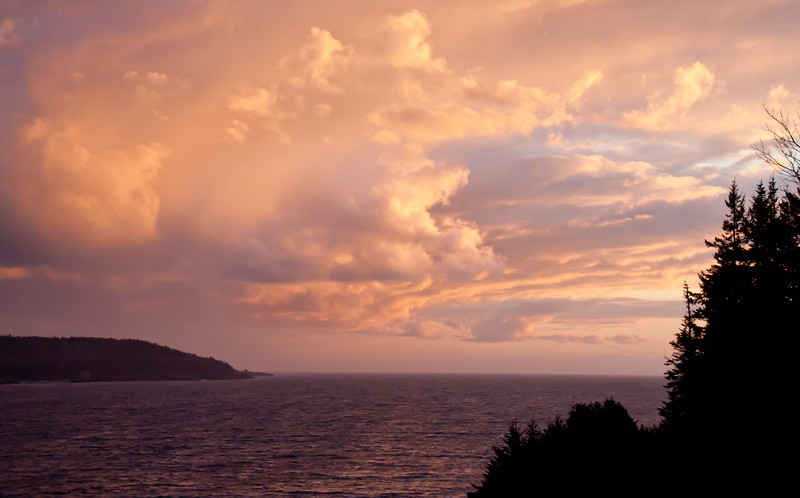 Small Point Harbor Sunset viewed from West Point, Totman Cove with Hermit Island in the background. Photographed in November, stunning clouds and sky with shades of pink, coral and light orange