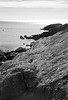 Rock ledge, granite from which Greyledge gets its name, Phippsburg Maine coastal scene looking south, Black and white