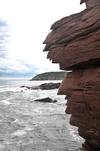 Thunder Hole, named for the loud booming made when water is forced with in coming tide upward and through the narrow gut of rocks, a famous feature of Acadia National Park area, Mount Desert Island, Maine in September, an iconic popular tourist destination