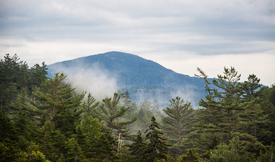 Fog rising over forest with Mount Katahdin in the background as seen from Ripogenus Dam on the Golden Road, Maine mid JulyFor more on the Ripogenus Gorge, dam and hydroelectric plant, see http://en.wikipedia.org/wiki/Ripogenus_Dam