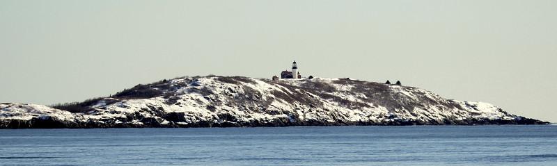Sequin Island Lighthouse In Winter scene from Popham Beach State Park, Phippsburg  Maine