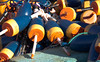 lobster bouys, just freshly painted in orange and blue, Friendship, Maine