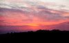 Brooding sunset over tree line, Phippsburg Maine
