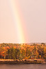 Rainbow with autumn foliage in gold, orange, yellow and red. Bailey Point, Phippsburg, Maine looking across Totman Cove from West Point, Phippsburg, Maine, fall scenic