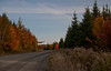 The Northern Road, north of Rockwood, Maine, late September, 2012, beautiful fall foliage with morning fog lifting from distant mountain top.