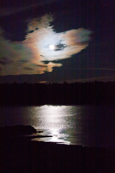 Full Hunger Moon, with full corona, February, Phippsburg Maine shining across Totman Cove