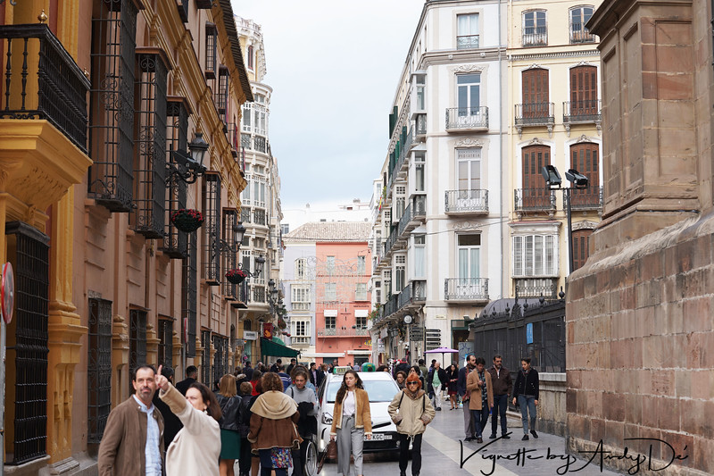 Candid camera capture of a busy street in Malaga, manifesting euphoria and joy in the wake of the Holiday Season!