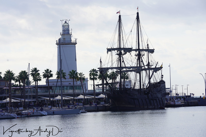 A schooner astride the Lighthouse at the Port of Malaga - a scene straight from Grimm's Fairly Tales captured for posterity!