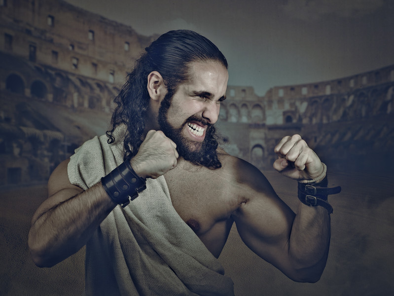 Antique fighter, gladiator. retro styled male portrait with abstract medieval backgrounds