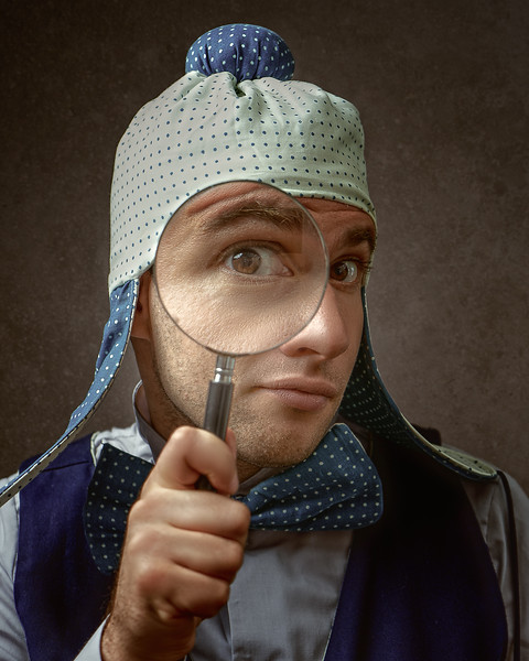Nerd, Funny male portrait with magnifier loupe