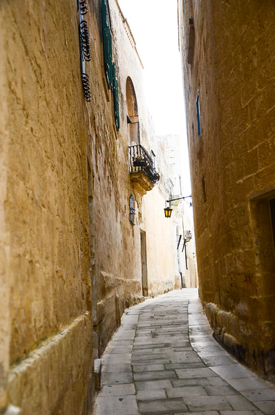 Winding Alleyways of Mdina<br /> <br /> Mdina, Città Vecchia, or Città Notabile, was the old capital of Malta. Mdina is a medieval walled town situated on a hill in the center of the island.