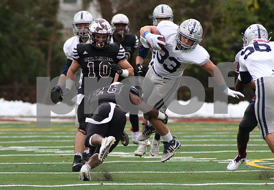 Manasquan's no.33, Canyon Birch and Hillside's no.28, Najee Peele. Manasquan High School v/s Hillside High School in the NJSIAA central group 2 championship in Hillside, NJ on 11/17/18. [DANIELLA HEMINGHAUS | THE COAST STAR]