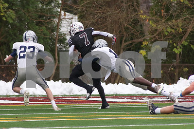 Manasquan no.14, Rashid Tuddles tackling Hillside's no.7, James Louis. Manasquan High School v/s Hillside High School in the NJSIAA central group 2 championship in Hillside, NJ on 11/17/18. [DANIELLA HEMINGHAUS | THE COAST STAR]