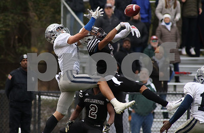 Hillside no.3, Emmanual Sass intercepting the ball from Manasquan's no.11, James Pendergist. Manasquan High School v/s Hillside High School in the NJSIAA central group 2 championship in Hillside, NJ on 11/17/18. [DANIELLA HEMINGHAUS | THE COAST STAR]