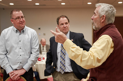 MAOSC Board member James Joy and Rep. Paul Marquart (DFL-Dilworth) listen to a point made by Board member Tim Burkhardt.