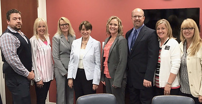 Sen. Amy Klobuchar (center) met with Minnesota Association of Small Cities Board members (from left) Jon Smith, Lori Jorgenson, Shannon Mortenson, Tina Rennemo, John Douville, Wendy Pederson and MAOSC Executive Director Jill Sletten.