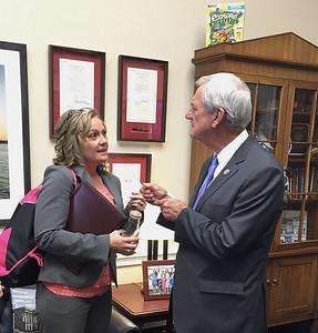 Minnesota Association of Small Cities President Tina Rennemo visits with Congressman Rick Nolan.