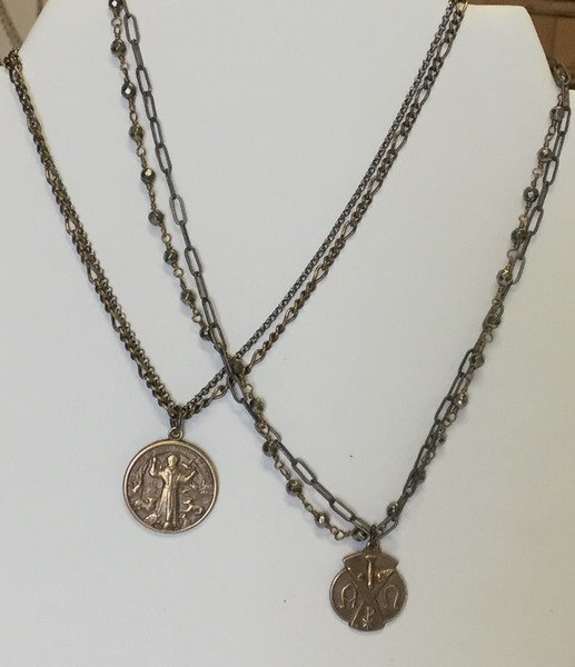 """LEFT:  7-2CH-RM96 CO49  ST FRANCIS WITH ANIMALS ON  2 OXIDIZED CHAINS   RIGH:  7-2CHN-RM127 CO57  ALPHA OMEGA MEDAL ON PYRITE AND DARK CHAIN   BOTH 16+2"""""""